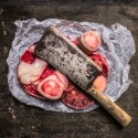 Raw Meat set for broth in paper and vintage cleaver